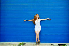 woman on wall background Royalty Free Stock Photo