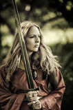 Sexy woman warrior with sword outdoor Royalty Free Stock Photography