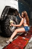 Sexy woman washing car Stock Photos