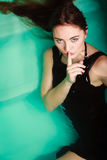 woman in water with finger silence sign. Stock Photo