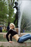 woman by water fountain Royalty Free Stock Photos