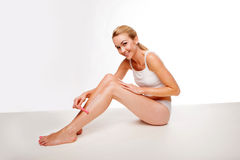 Sexy woman waxing her legs Stock Photos
