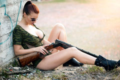 Sexy woman with weapon Royalty Free Stock Image