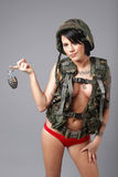 Sexy woman wearing army gear Stock Photography