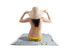Sexy woman wearing bikini sitting on mat Royalty Free Stock Photo