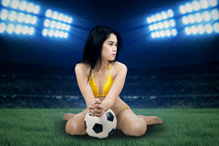 Sexy woman wearing bikini at stadion Royalty Free Stock Images