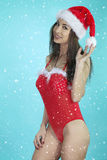Sexy woman wearing a christmas costume Royalty Free Stock Photos
