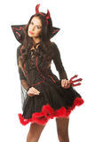 Sexy woman wearing devil clothes, standin astride, holding trident. Sexy woman wearing devil clothes, standing astride, holding trident Royalty Free Stock Photo