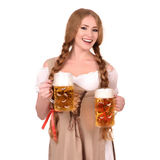 Sexy woman wearing a dirndl with two beer mugs over white Stock Photo