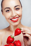 Sexy Woman wearing Eating Strawberry. Stock Images