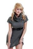 Sexy woman wearing a grey knit dress Stock Photo