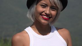 Woman Wearing Red Lipstick. A young platinum blonde adult female royalty free stock image