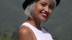 Woman Wearing Red Lipstick. A young platinum blonde adult female stock photo