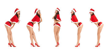 Sexy woman wearing santa claus clothes. Collage of sexy woman wearing santa claus clothes  isolated on white background Royalty Free Stock Photos