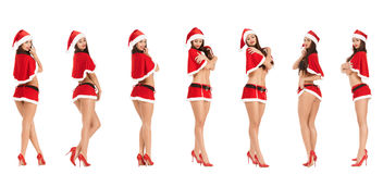 Sexy woman wearing santa claus clothes. Collage of sexy woman wearing santa claus clothes  isolated on white background Royalty Free Stock Photo