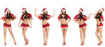 Sexy woman wearing santa claus clothes. Collage of sexy woman wearing santa claus clothes  isolated on white background Royalty Free Stock Images
