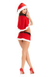 Sexy woman wearing santa claus clothes. Isolated on white background Royalty Free Stock Image