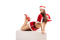 Sexy woman wearing santa claus clothes. Portrait of young sexy woman wearing santa claus clothes  isolated on white background Royalty Free Stock Photo