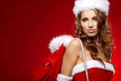 Sexy woman wearing santa clause costume Royalty Free Stock Images