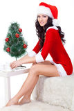 woman wearing santa helper costume Royalty Free Stock Photography