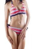 Sexy woman wearing striped bikini Stock Photography