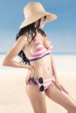 woman wearing striped bikini posing Royalty Free Stock Photography
