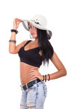 Sexy woman wearing summer hat showing great body. In jeans Stock Photos