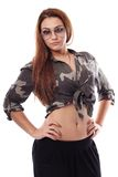 Sexy woman wearing sunglasses, army shirt and standing akimbo. Studio portrait of sexy woman wearing sunglasses and army shirt standing akimbo isolated on white Royalty Free Stock Images