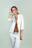 Sexy woman wearing white suit Stock Image