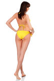 Sexy woman wearing yellow swimsuit Royalty Free Stock Images