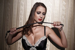 Sexy woman with whip at night Royalty Free Stock Image