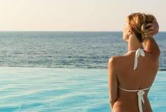 woman in white bikini looking far Stock Photography