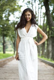 Sexy woman in a white dress on the street Royalty Free Stock Photography