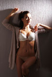 A sexy woman in white erotic lingerie Royalty Free Stock Images