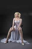 Sexy woman in white fashion dress sit on chair Royalty Free Stock Photos