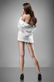 Sexy woman in white jacket Royalty Free Stock Image