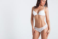 Sexy woman in a white lingerie on the background Stock Image