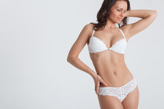 Sexy woman in a white lingerie on the background Royalty Free Stock Photography