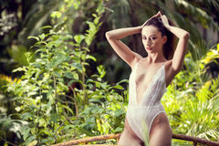 Sexy woman in white lingerie in tropical enviroment Stock Image