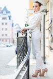Sexy woman in white pants and jacket Royalty Free Stock Image