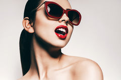 Sexy woman with white teeth in sunglasses Royalty Free Stock Image