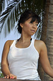 Beautiful Asian woman white top under palm tree Royalty Free Stock Photos