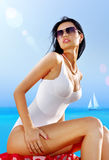 Sexy woman in white wear on beach Royalty Free Stock Photography