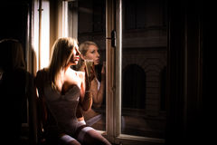 Sexy woman at window Royalty Free Stock Images