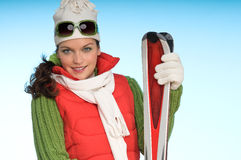 Sexy woman in winter outfit with skis Stock Photography