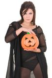 Sexy woman witch with halloween pumpkin Royalty Free Stock Photos