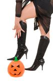 Sexy woman witch legs in halloween pumpkin Stock Photo