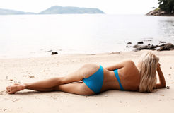 Sexy Woman With Blond Hair In Elegant Bikini Relaxing On Beach Stock Photography