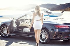 Free Sexy Woman With Luxury Car And Airplane. Stock Photo - 99830350