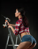 Sexy woman worker. On ladder Stock Image